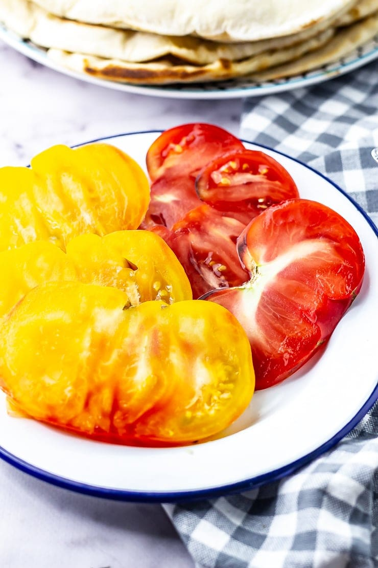 Tomatoes for mushroom wraps with a checked cloth