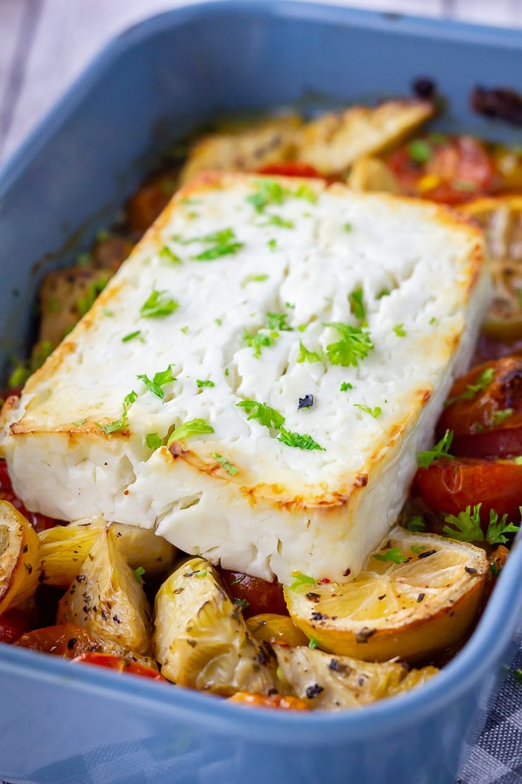 Baked feta with vegetables in a blue baking dish