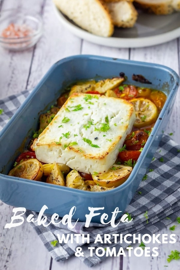 This baked feta is so easy to make and is so good served with some crusty bread. Switch up the vegetables you use to make it suit the season. #bakedfeta #feta #vegetarian #tomatoes #artichokes #baked #bake #healthy #easyrecipe #weeknightrecipe #thecookreport