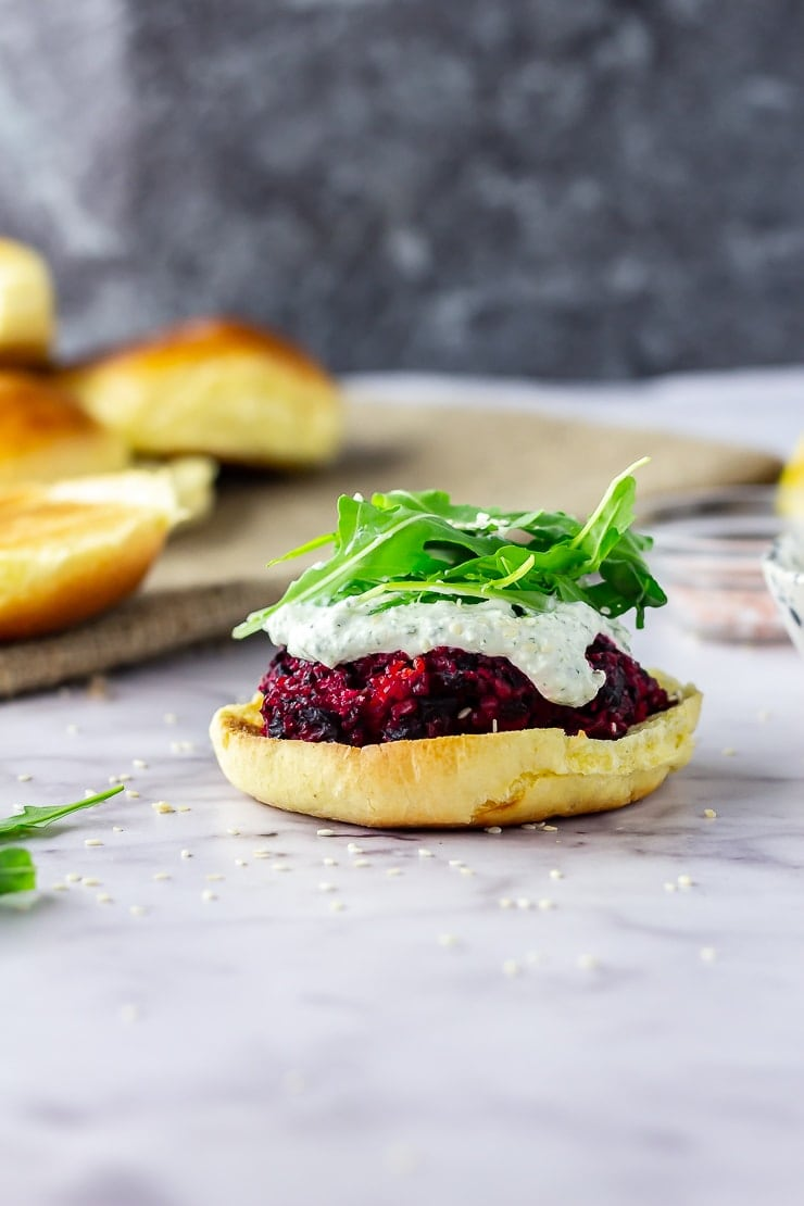 Side on shot of beetroot burgers on a marble background