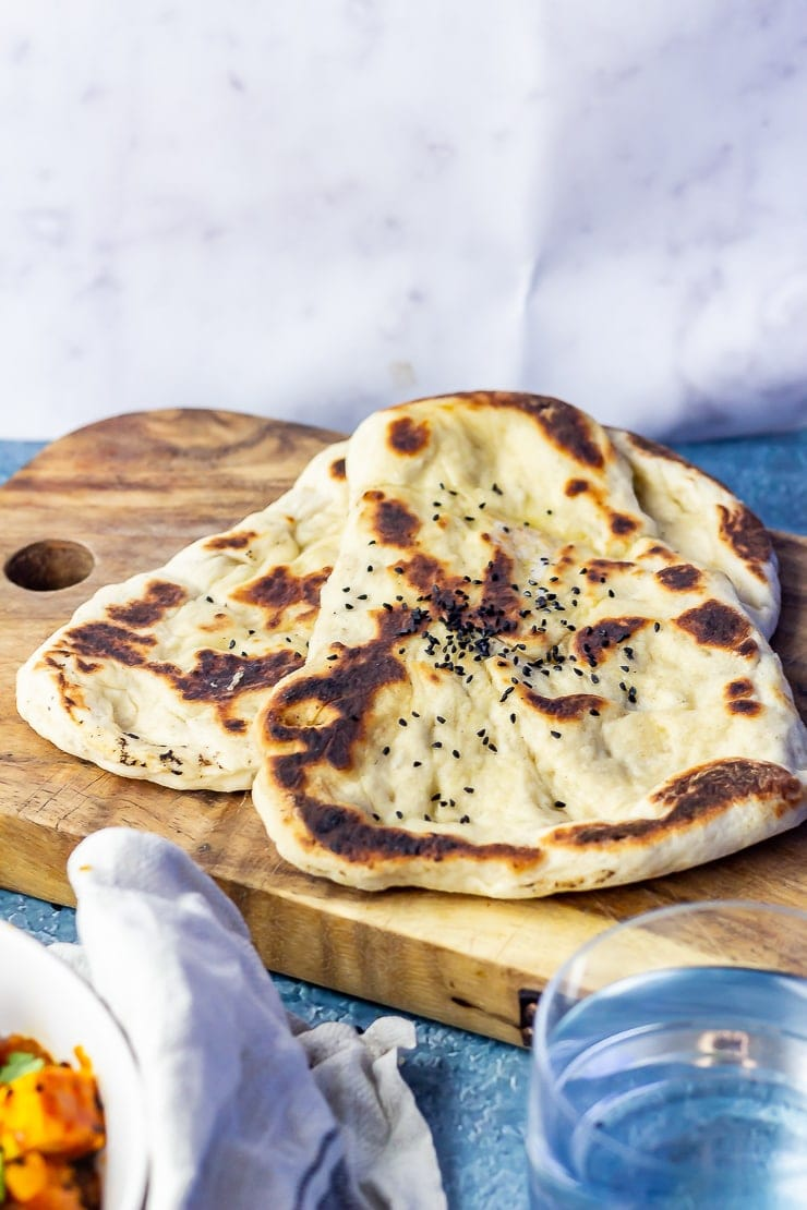 Photo of naan bread on a wooden board