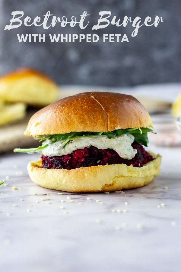 These roasted beetroot burgers are filling, healthy and perfect for your autumn dinner. Smear with a big dollop of whipped feta and serve in a toasted brioche bun. #beetroot #beetrootburger #vegetarian #easydinner #falldinner #autumndinner #healthydinner #feta #whippedfeta #thecookreport