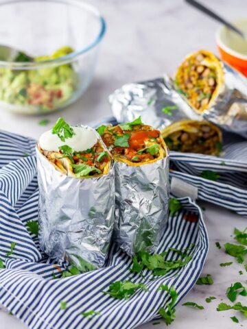Vegetarian breakfast burrito on a striped cloth