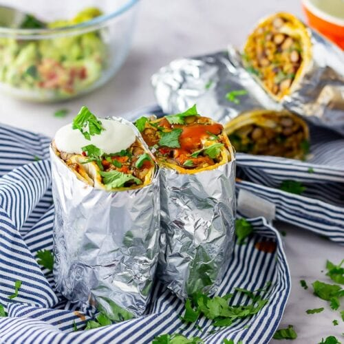 Vegetarian breakfast burrito on a striped cloth