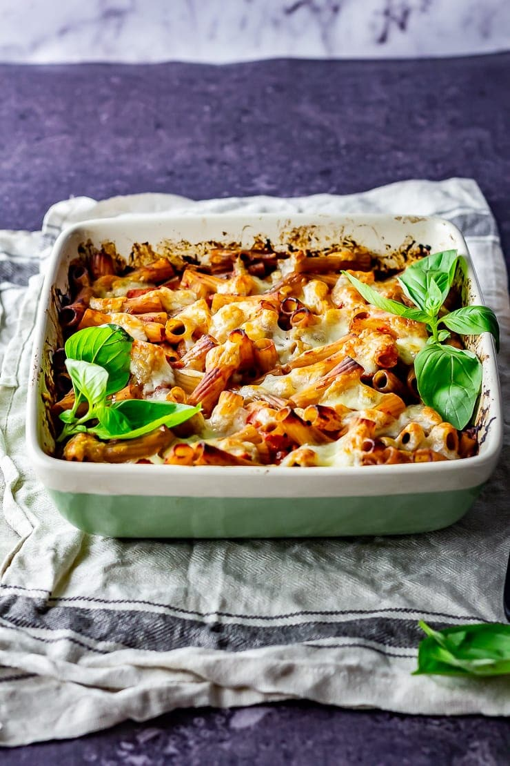 Side shot of cheese and tomato pasta bake on a cloth