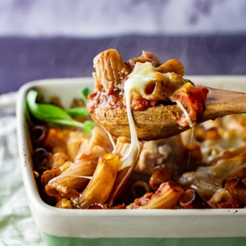 One pot cheese and tomato pasta bake with a spoonful being taken