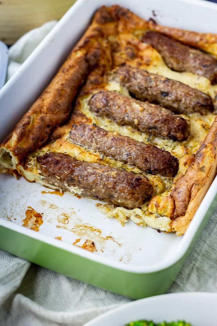 Vegetarian toad in the hole in a green baking dish