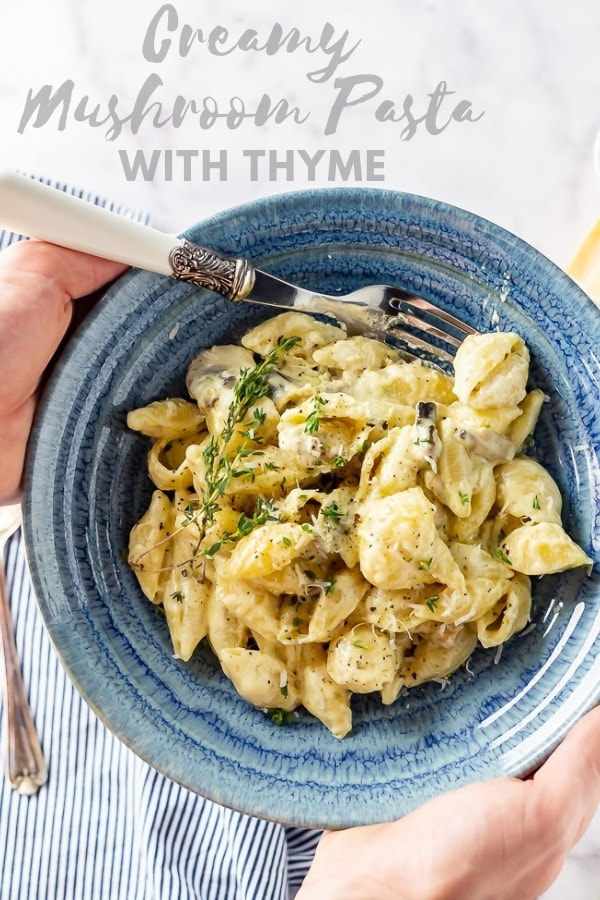Pinterest image for creamy mushroom pasta with text overlay