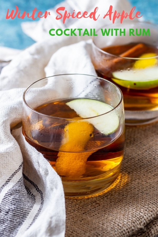 Pinterest image for spiced apple cocktail with rum with text overlay
