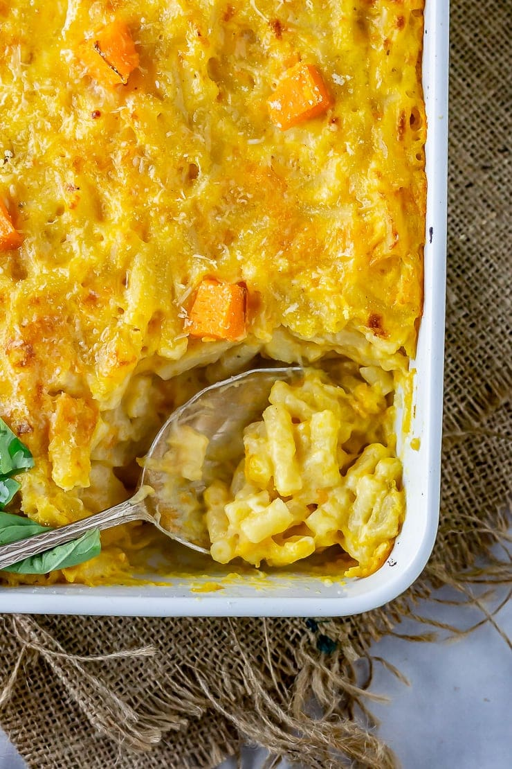 Overhead shot of sweet potato mac and cheese with a spoonful taken