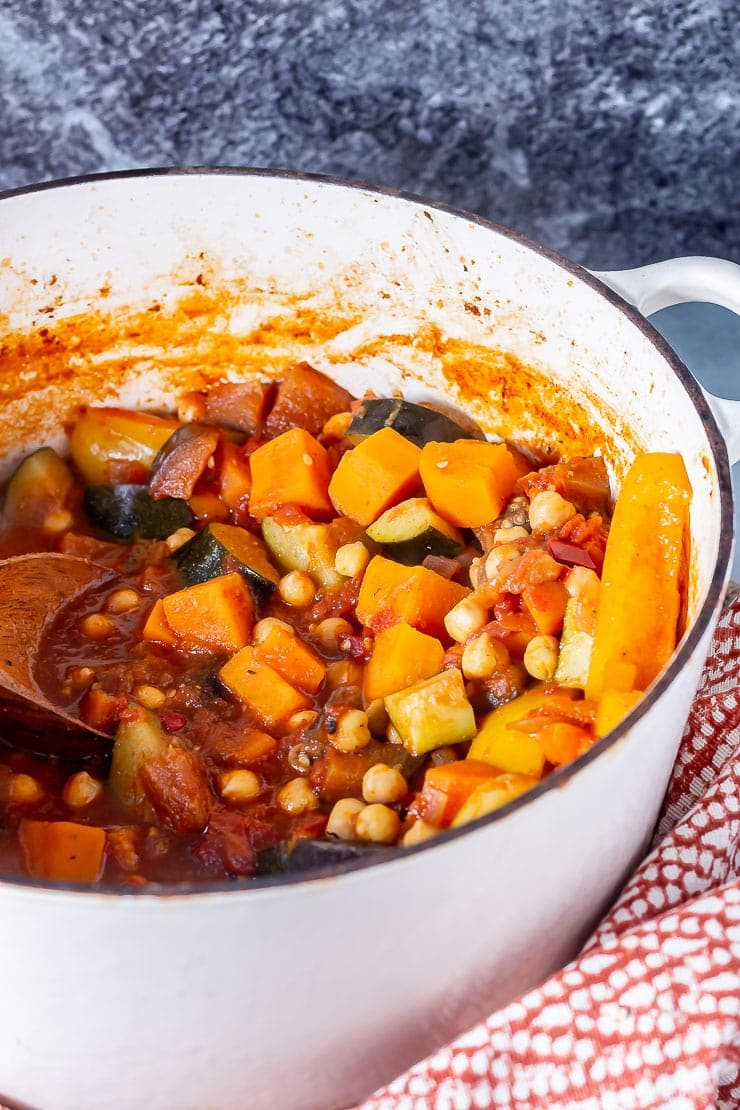 Side on shot of vegetable tagine in a white pot