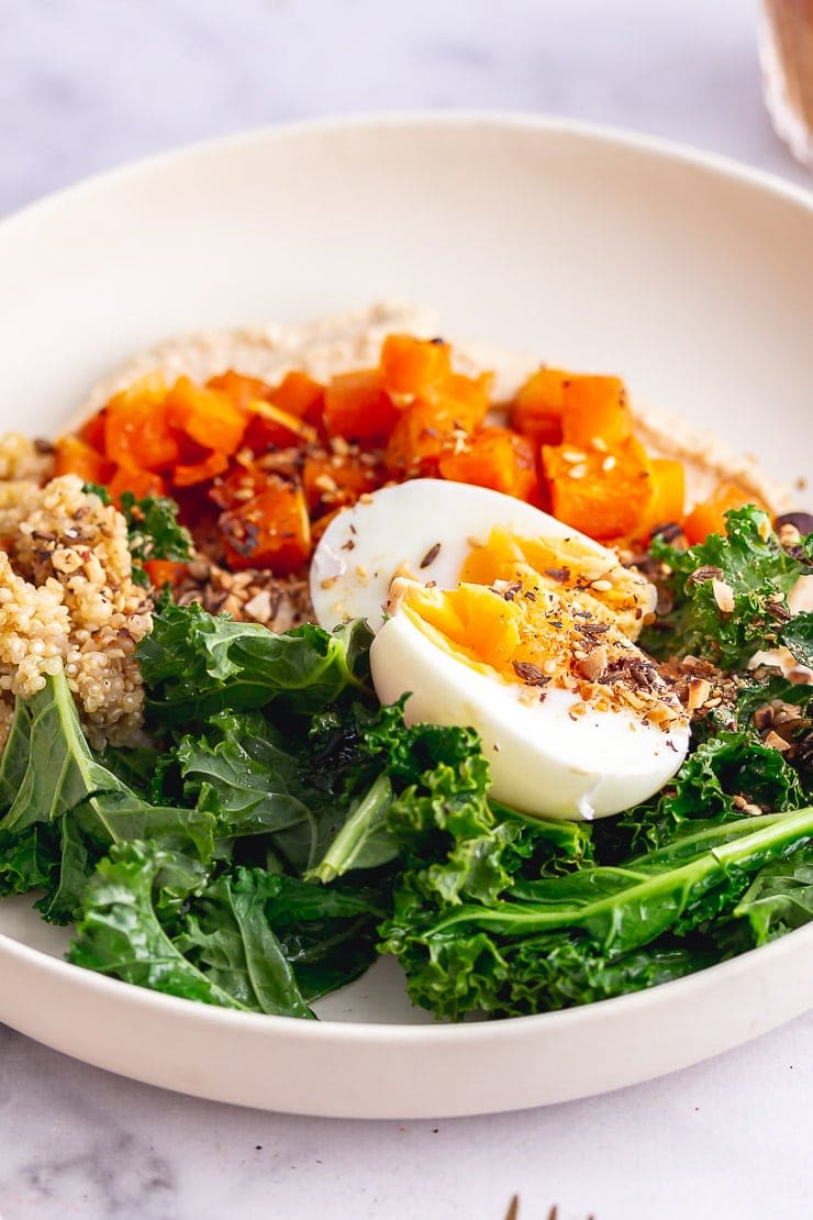 Vegetarian breakfast bowl with egg and butternut squash