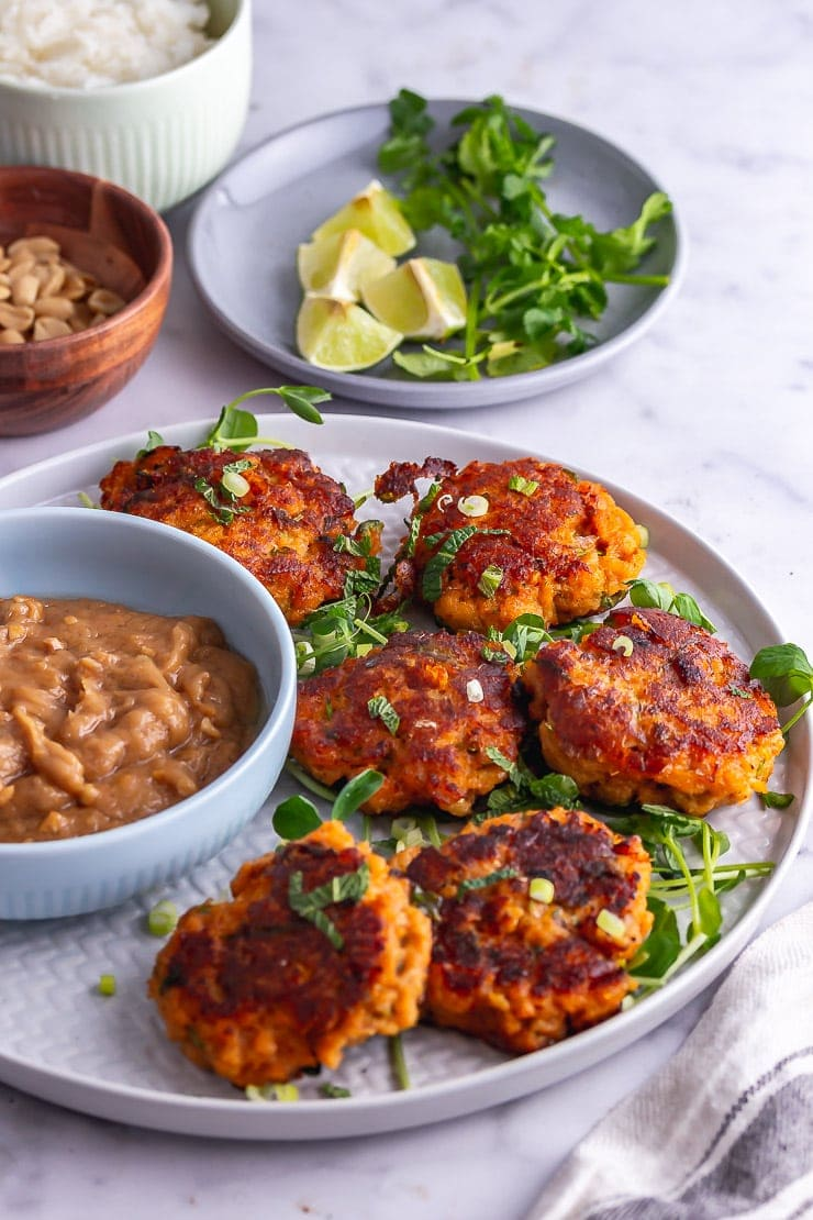 Plate of Thai fish cakes with greens on a marble background