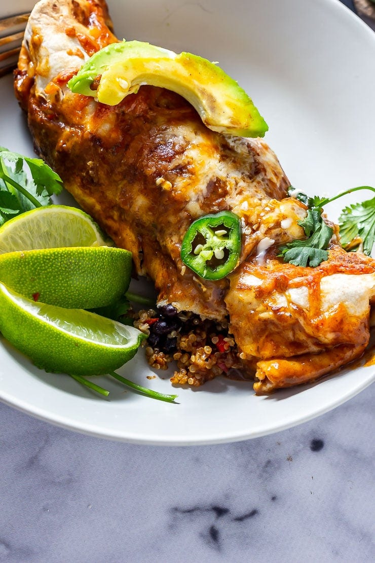Vegetarian enchilada in a bowl with lime and avocado