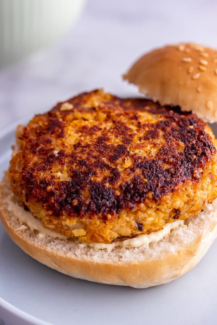 Veggie burgers on a plate without a top bun