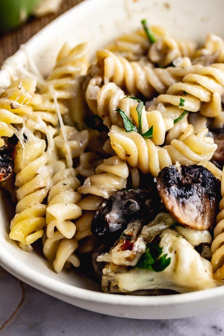 White bowl of creamy mushroom pasta bake
