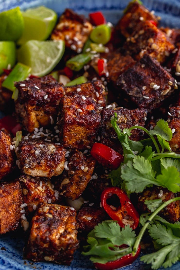 Close up of salt and pepper tofu with lime, chilli and coriander