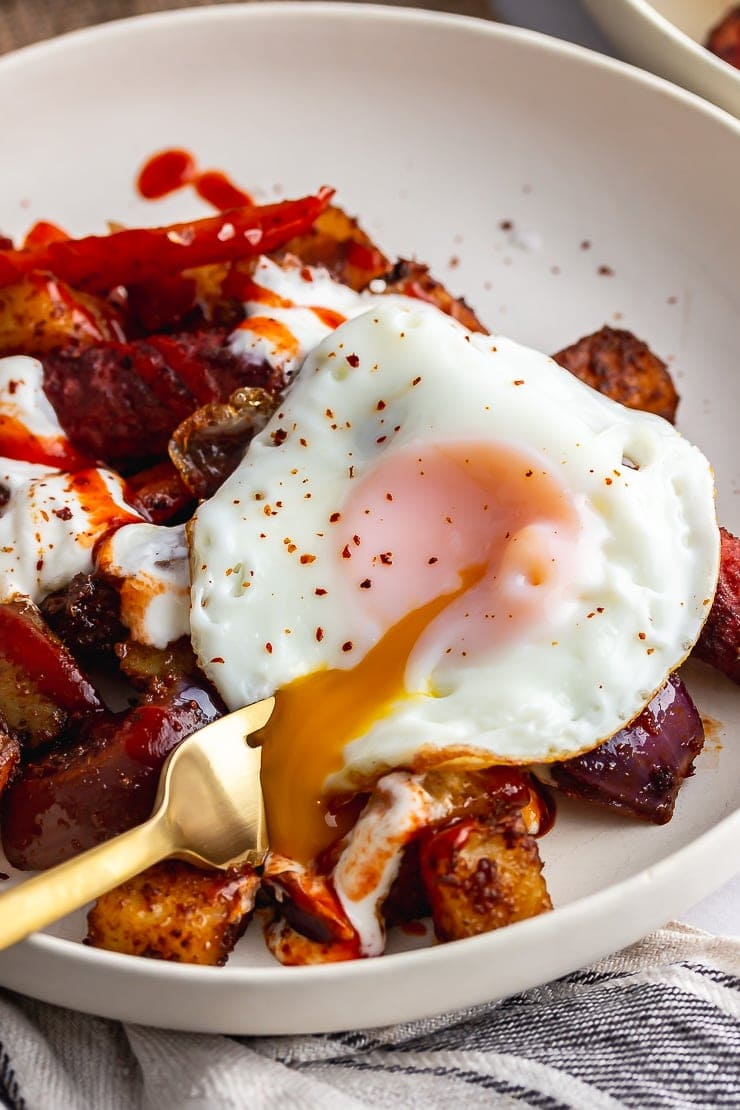 Veggie sausage bake topped with a runny fried egg