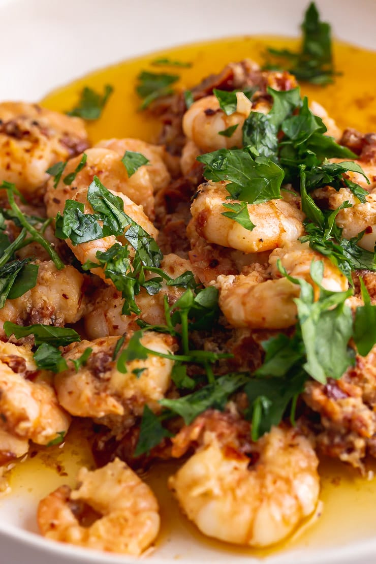 Close up of chilli prawns with parsley