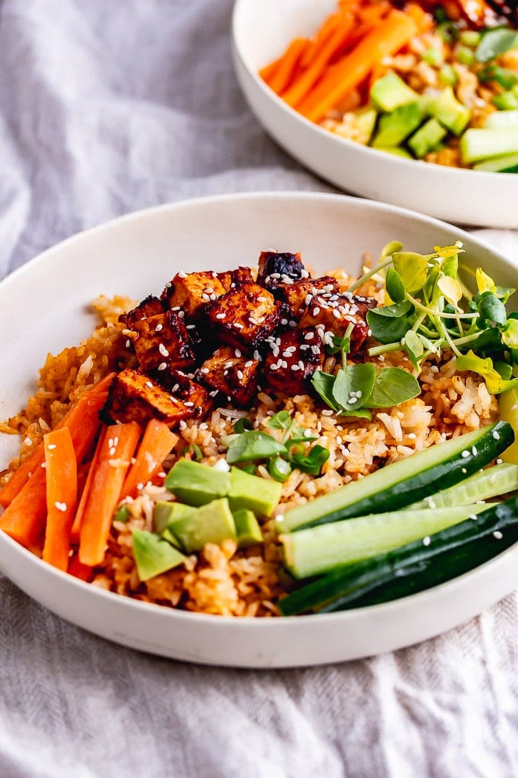 Spicy rice bowls on a cotton background