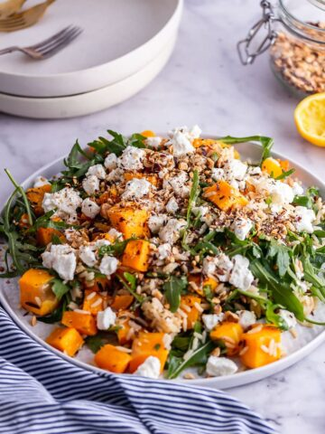 Grey plate of butternut squash salad with rocket