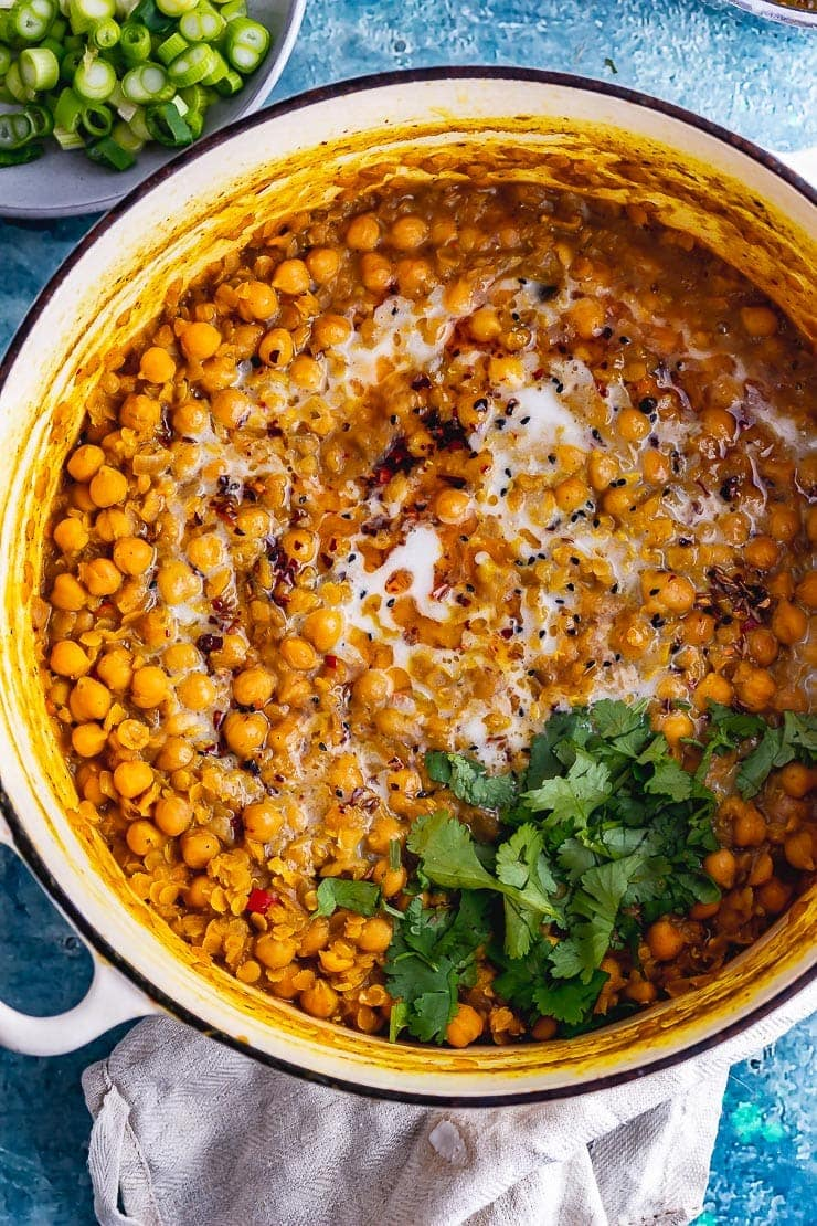 Overhead shot of a white pot of chickpea curry