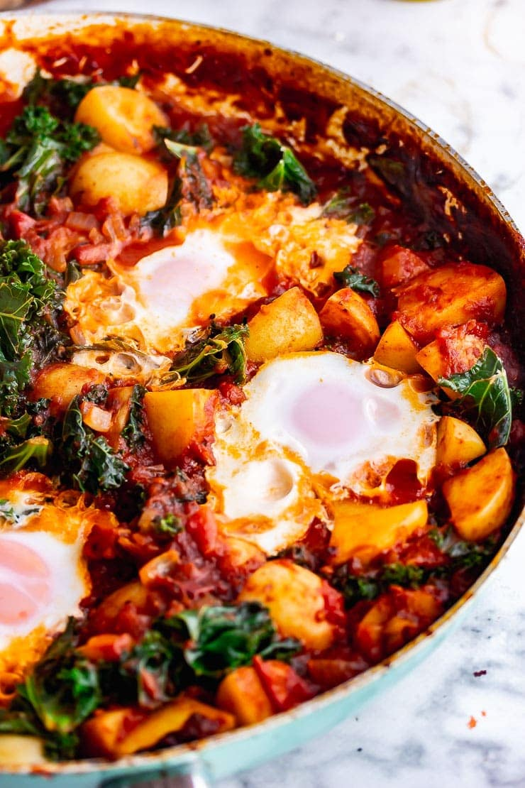 Close up of chipotle eggs and potatoes with kale