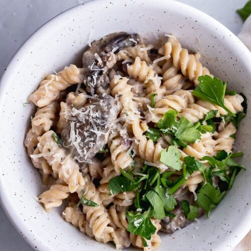 Overhead shot of pressure cooker creamy mushroom pasta in a white bowl