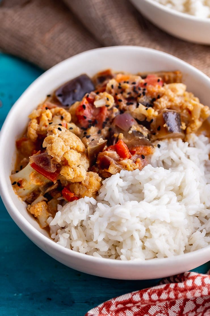 White bowl of pressure cooker vegetable curry with rice
