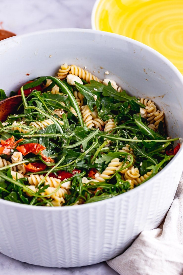 Grey bowl of roasted tomato pasta salad