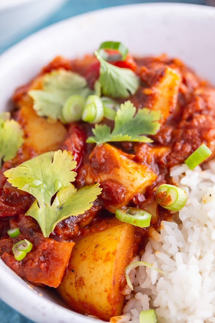 Close up of spicy halloumi curry in a white bowl