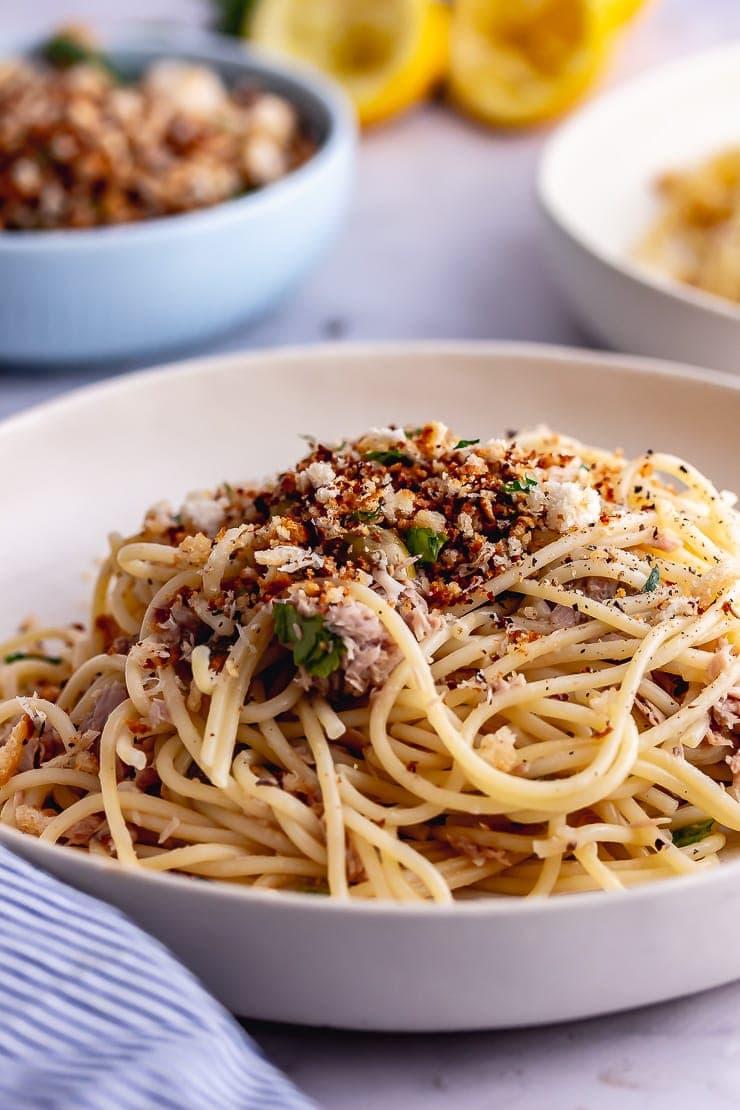 Tuna pasta with pangratatto in a white bowl