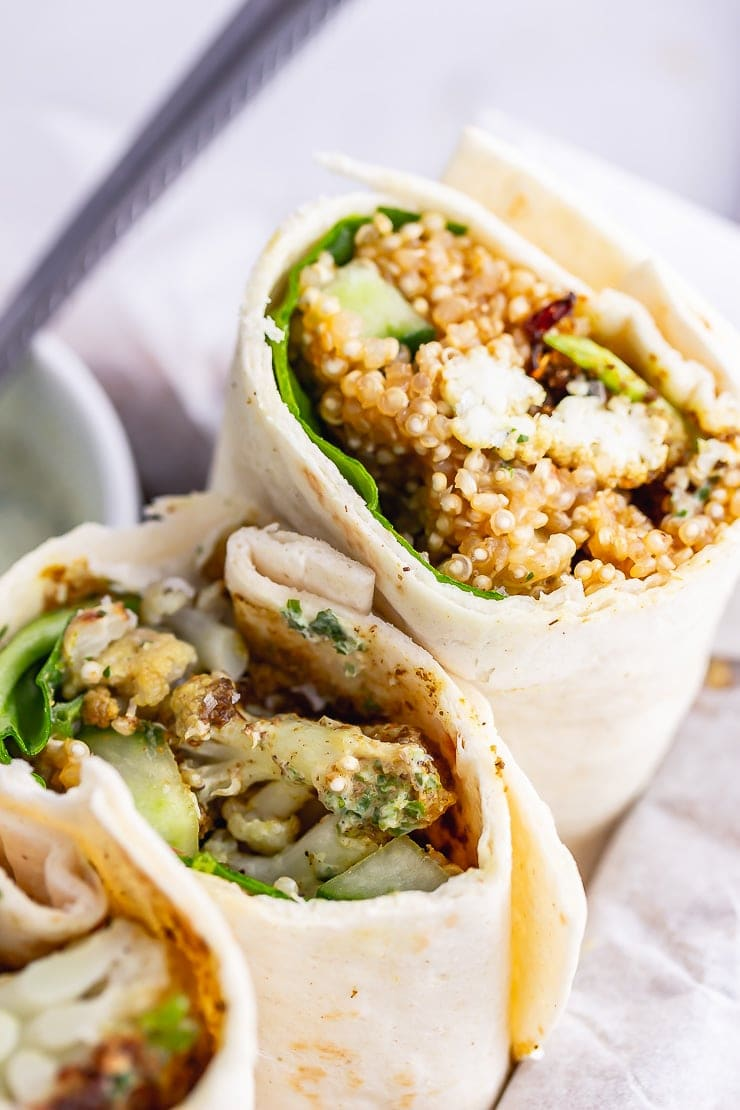 Close up of a veggie wrap in paper