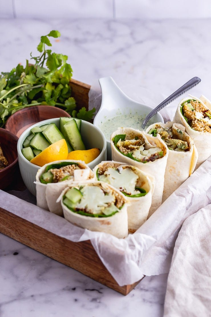 Veggie wrap in a wooden tray on a marble background