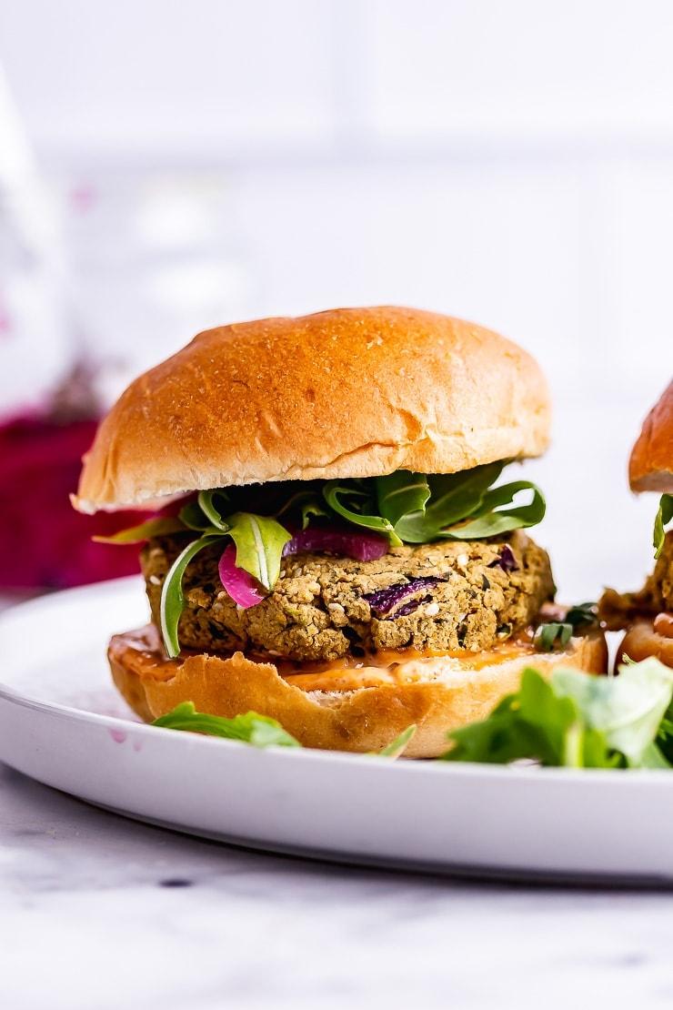Side on shot of a falafel burger with rocket