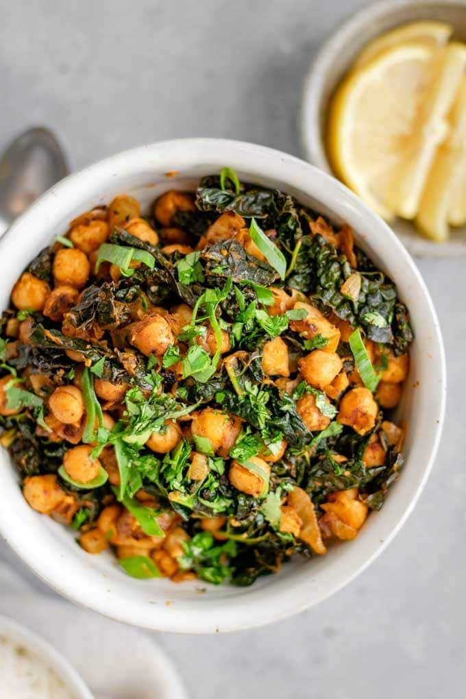 Indian Spiced Chickpeas and Greens in a white bowl