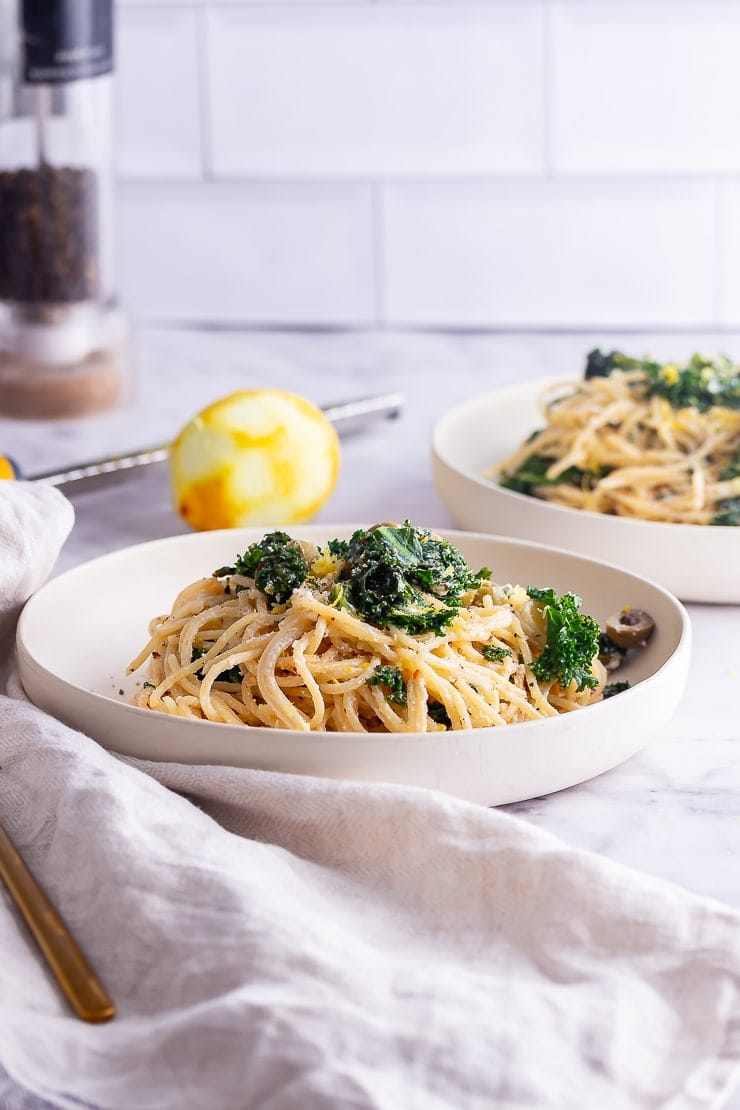 Side on shot of roasted garlic spaghetti with kale