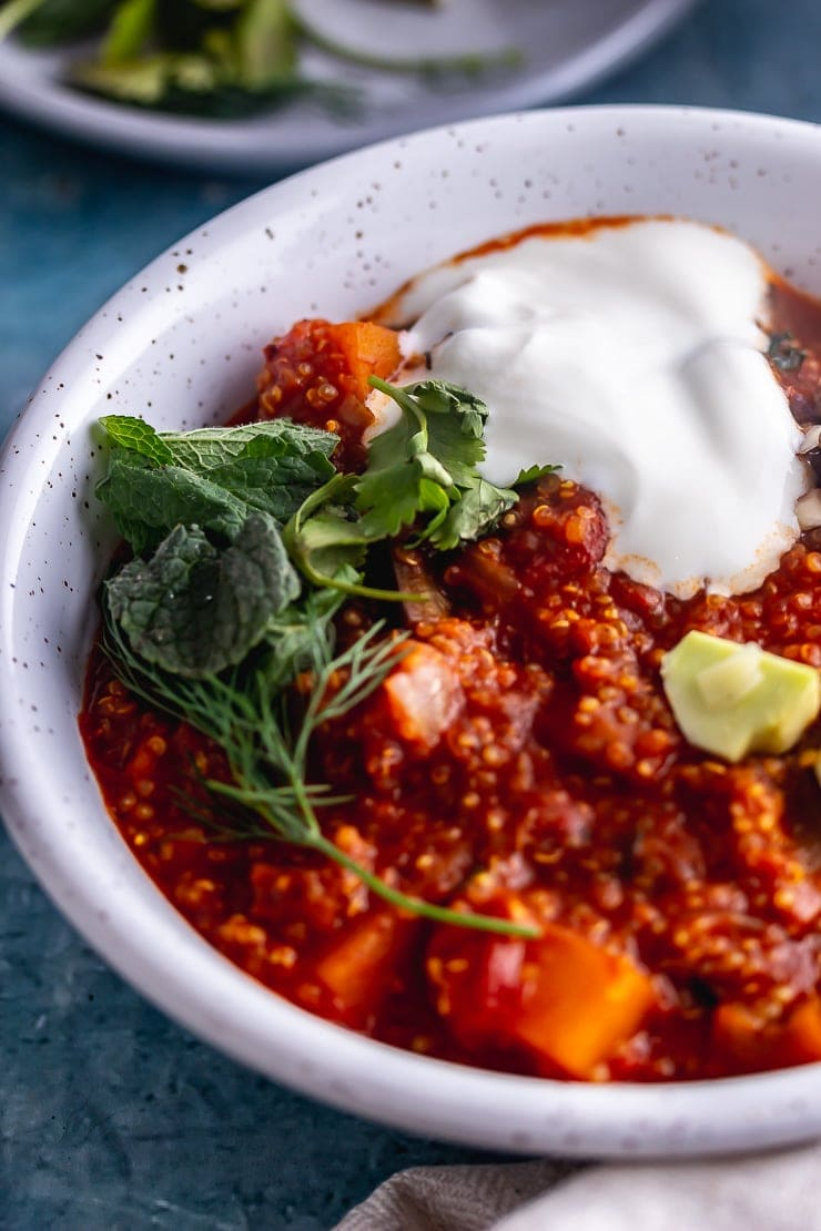 Close up of spicy veggie stew with herbs and yoghurt