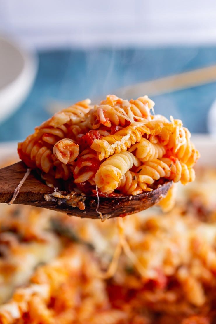 Wooden spoonful of sausage pasta bake