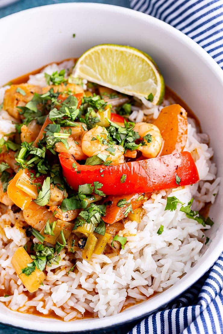 Close up of Thai prawn curry with rice and lime