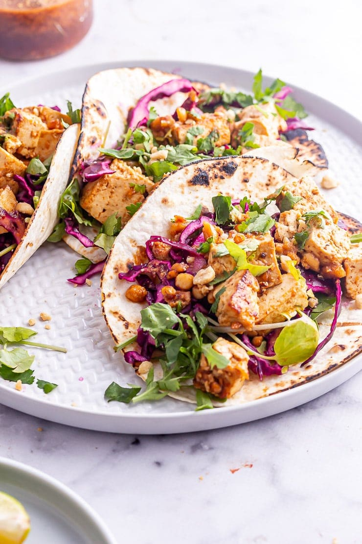 Tofu tacos on a platter with coriander