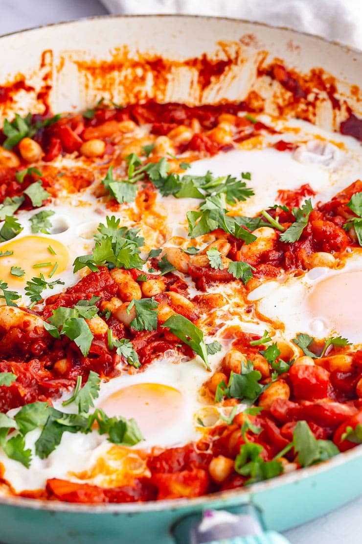Close up of spicy beans with eggs and herbs