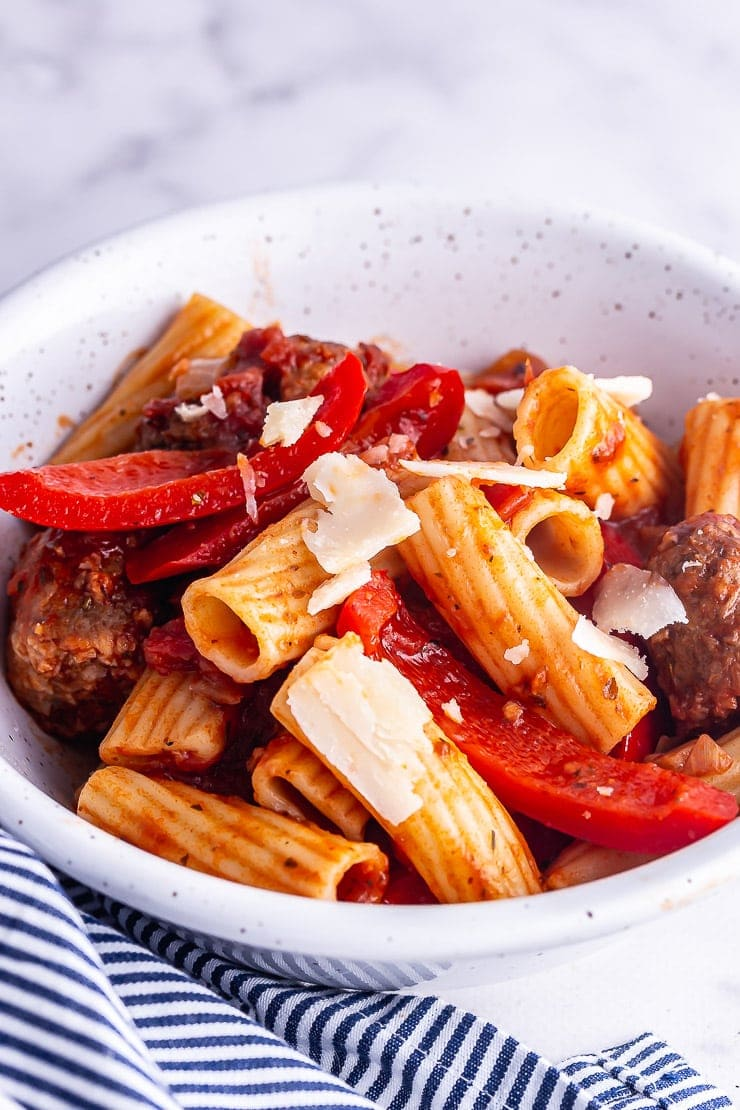 Close up of sausage pasta with peppers and parmesan