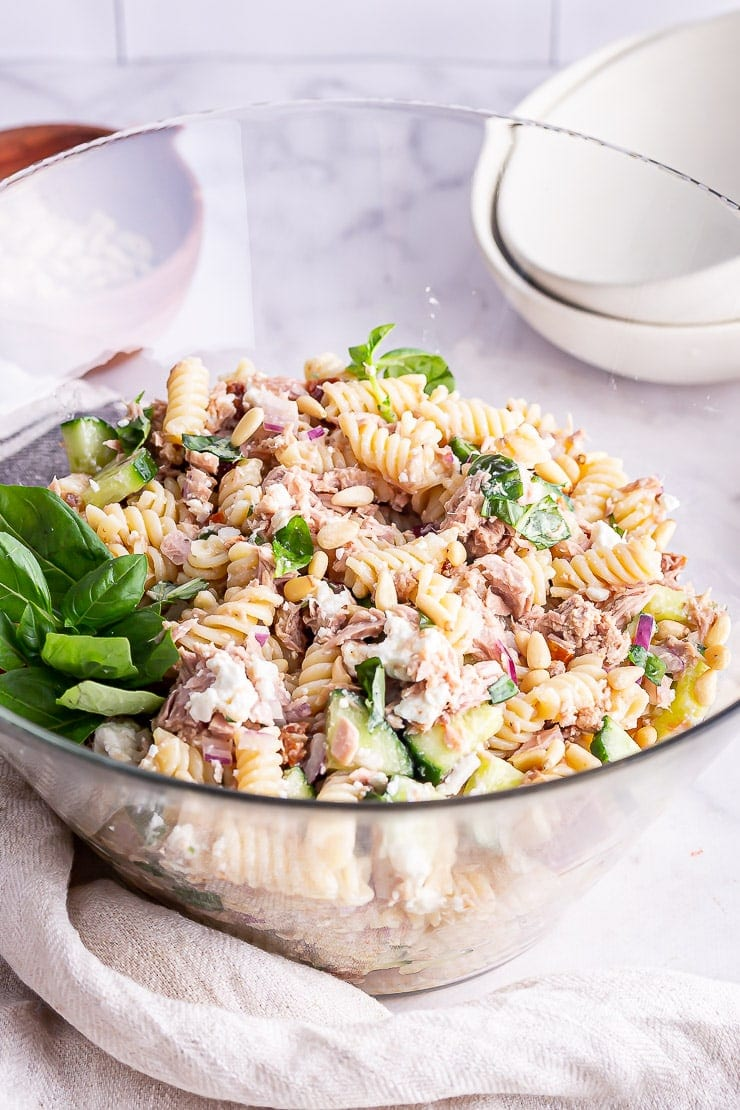 Glass bowl of tuna pasta salad in a marble surface