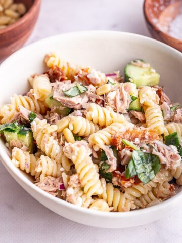 Close up of tuna pasta salad in a white bowl