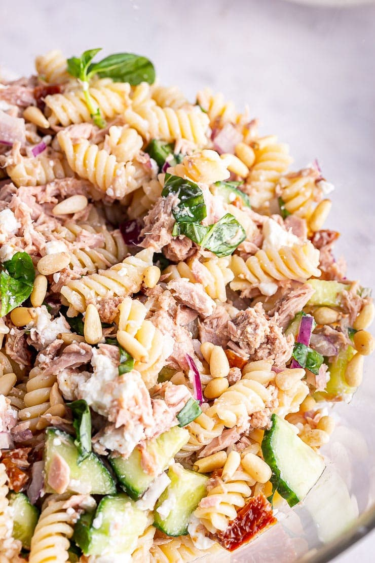 Close up of tuna pasta salad with cucumber