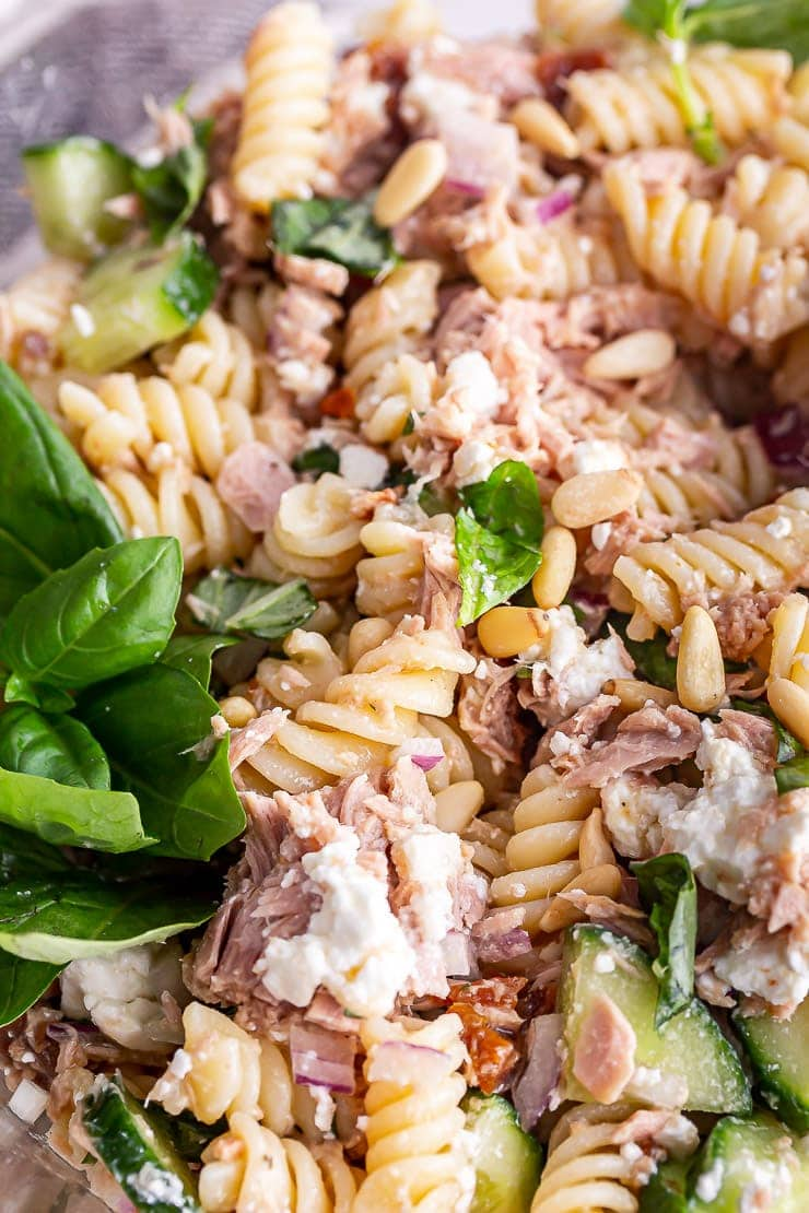 Close up of tuna pasta salad with basil and feta