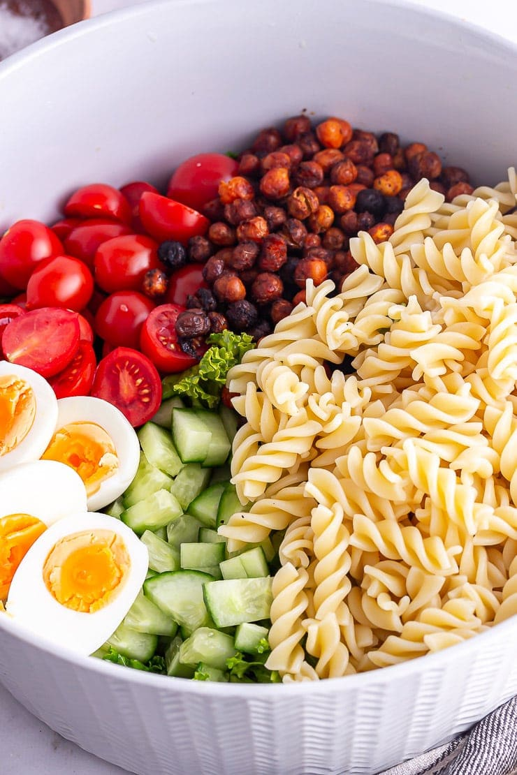 Grey bowl of pasta cobb salad ingredients