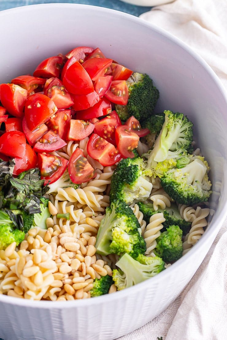 Vegan pasta salad ingredients in a grey bowl