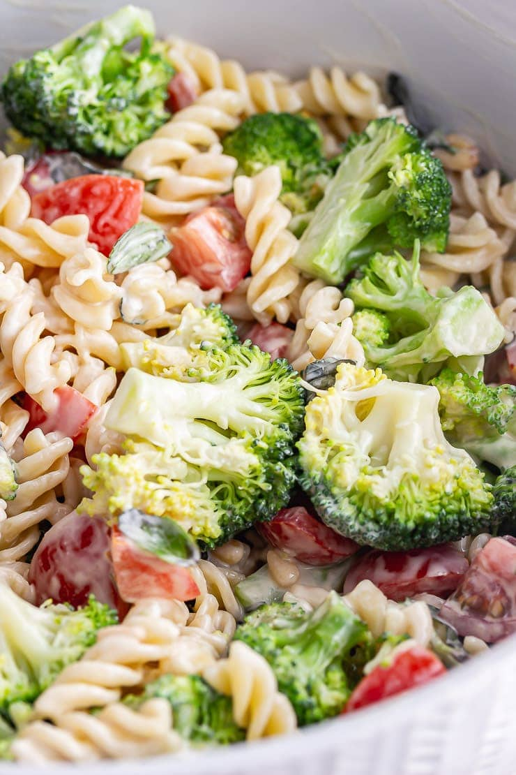 Close up of vegan pasta salad with broccoli and tomato